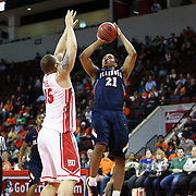 Malcolm Hill #21 of the Illinois Fighting Illini shoots the ball over Dom Morris #15 of the Boston University Terriers during the NIT First Round game at Agganis Arena on March 19, 2014 in Boston, Massachusetts . (Photo by Elan Kawesch)