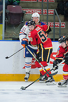 PENTICTON, CANADA - SEPTEMBER 17: Dillon Dube #59 of Calgary Flames checks Braden Christoffer #61 of Edmonton Oilers into the boards on September 17, 2016 at the South Okanagan Event Centre in Penticton, British Columbia, Canada.  (Photo by Marissa Baecker/Shoot the Breeze)  *** Local Caption *** Dillon Dube; Braden Christoffer;