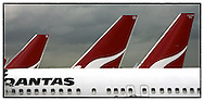 Copyright JIm Rice © 2013.Qantas jets at terminal