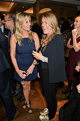 Left to right, SARA PARKER BOWLES and her sister in law LAURA LOPES  at a party to celebrate the publication of 'Let's Eat meat' by Tom Parker Bowles held at Fortnum & Mason, Piccadilly, London on 21st October 2014.