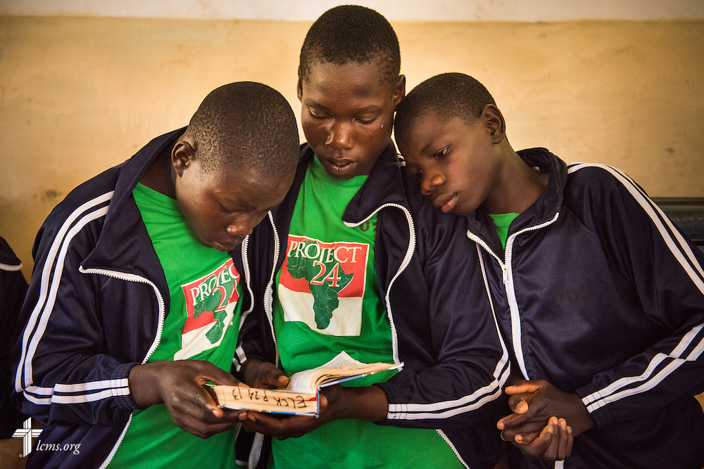 Young men read during Bible study at the Othoro ELCK (Evangelical Lutheran Church in Kenya) Project 24 boarding facility on Sunday, Oct. 18, 2015, in Kisumu, Kenya. LCMS Communications/Erik M. Lunsford
