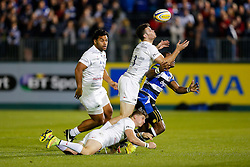 Saracens Outside Centre Duncan Taylor takes the ball under pressure from Bath Winger Semesa Rokoduguni - Photo mandatory by-line: Rogan Thomson/JMP - 07966 386802 - 03/10/2014 - SPORT - RUGBY UNION - Bath, England - The Recreation Ground - Bath Rugby v Saracens - Aviva Premiership.