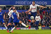 Chelsea midfielder Eden Hazard (10) and Tottenham Hotspur midfielder Eric Dier (15) clash over the ball during the EFL Cup semi final second leg match between Chelsea and Tottenham Hotspur at Stamford Bridge, London, England on 24 January 2019.