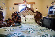 Mestilde Shigwedha, a diamond polisher for NamCot Diamonds in Windhoek, Namibia, in her bedroom after a work day at the factory. (From the book What I Eat: Around the World in 80 Diets.) MODEL RELEASED.