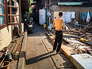 14 OCTOBER 2015 - BANGKOK, THAILAND: A man looks at a destroyed home in the Wat Kalayanamit neighborhood. Fifty-four homes around Wat Kalayanamit, a historic Buddhist temple on the Chao Phraya River in the Thonburi section of Bangkok, are being razed and the residents evicted to make way for new development at the temple. The abbot of the temple said he was evicting the residents, who have lived on the temple grounds for generations, because their homes are unsafe and because he wants to improve the temple grounds. The evictions are a part of a Bangkok trend, especially along the Chao Phraya River and BTS light rail lines. Low income people are being evicted from their long time homes to make way for urban renewal.         PHOTO BY JACK KURTZ