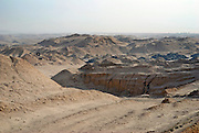 The Tyre Graveyard<br /> <br /> World's biggest tyre graveyard: Incredible images of Kuwaiti landfill site that is home to SEVEN MILLION wheels and so huge it can be seen from space<br /> <br /> An average car tyre will travel around 20,000 miles over its lifetime, but when they have reached the end of their life in Kuwait... they are destined for the tyre graveyard.<br /> <br /> In Kuwait City's Sulaibiya area every year gigantic holes are dug out out in the sandy earth and filled with old tyres - there are now over seven million in the ground.<br /> <br /> The expanse of rubber is so vast that the sizable indents on the earth are now visible from space.<br /> <br /> It is thought the tyres are from both Kuwait and other countries which have paid for them to be taken away - four companies are in charge of the disposal and are thought to make a substantial amount from the disposal fees.<br /> <br /> The European landfill directive means that this type of 'waste disposal would be illegal in Europe -  since 2006 EU rules have banned the disposal of tyres in landfill sites, leaving about 480,000 tonnes of recyclable shredded rubber each year<br /> <br /> In Britain all car and truck tyres must be recovered, recycled and reused.<br /> <br /> Currently, more than 80 per cent of the 55 million used tyres generated in Britain are processed via the Responsible Recycler Scheme.<br /> <br /> The scheme ensures full traceability and accountability of waste tyres throughout the disposal chain, from collection through to their final reuse in an environmentally friendly or acceptable method.<br /> <br /> Materials from properly recycled tyres are used for a variety of uses including a children's playground, running tracks, artificial sports pitches, fuel for cement kilns, carpet underlay, equestrian arenas and flooring.<br /> <br /> Bales of tyres can be used in the construction of modern engineered landfill sites and flood defences. If waste tyres are in good condition, they can