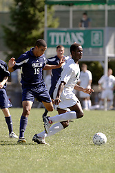 01 October 2006: Titan Ikenna Odinaka gets position on Crusader Jered Lee. The game remained scoreless until the 2nd overtime in which University of Dallas Crusaders Adam Lunger scored the Golden Goal to beat the Illinois Wesleyan Titans.  This game was played at Neis Field on the campus of Illinois Wesleyan University in Bloomington Illinois.