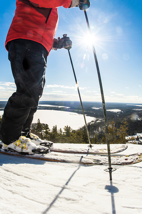 A skier explores the cliff drops and rocky chutes of the Extreme Backcountry area of  Mount Bohemia ski area on Michigan's Keweenaw Peninsula.