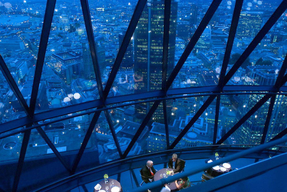 30 St Mary Axe, also known as the Gherkin and the Swiss Re Building, is a skyscraper in London's main financial district, the City of London. Photo shows the restaurant and bar area at the top..Photos ©Steve Forrest