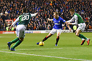 Scott Arfield and Vykintas Slivka tangle during the Ladbrokes Scottish Premiership match between Hibernian and Rangers at Easter Road, Edinburgh, Scotland on 19 December 2018.