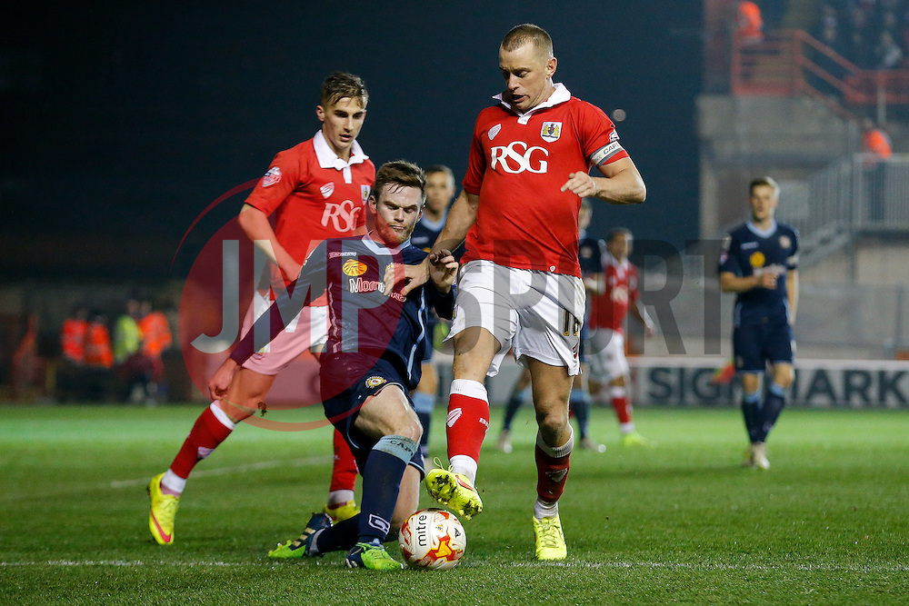 Aaron Wilbraham of Bristol City is challenged by Oliver Turton of Crewe Alexandra - Photo mandatory by-line: Rogan Thomson/JMP - 07966 386802 - 17/03/2015 - SPORT - FOOTBALL - Bristol, England - Ashton Gate Stadium - Bristol City v Crewe Alexandra - Sky Bet League 1.