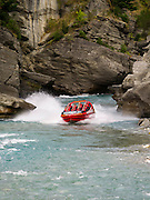 A Shotover River jet boat on the Shotover River approaching the landing; near Queenstown, NZ