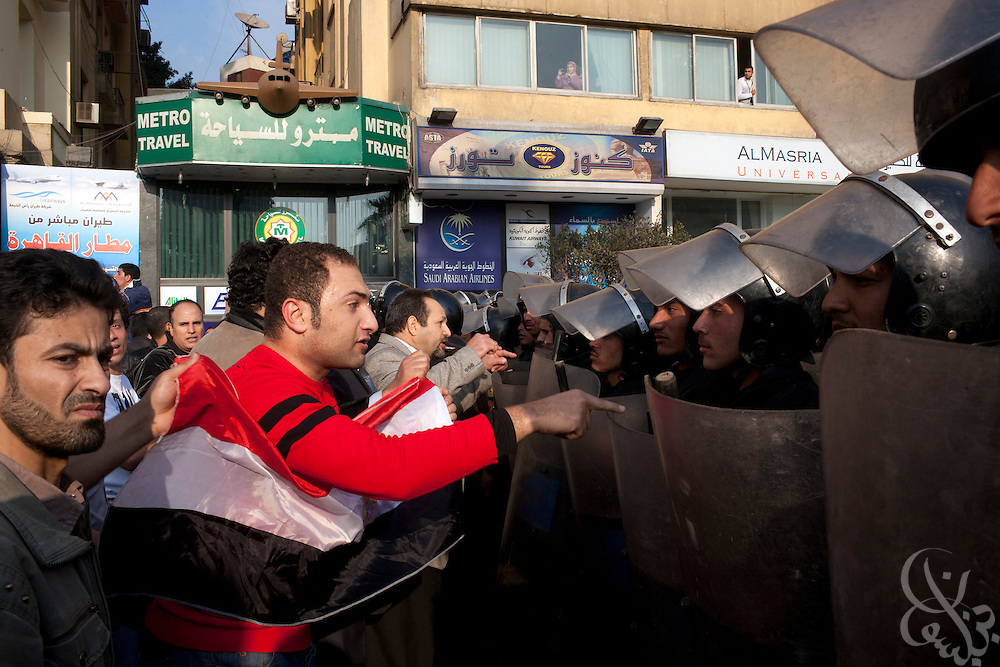 "Egyptian protestors try to persuade a line of riot police to let them pass during January 25, 2011 ""Day of Anger"" demonstrations in downtown Cairo, Egypt. Today's protests across Egypt, inspired by the revolution in Tunisia, were organized by a wide range of opposition groups and intended to spark a similar movement in Egypt.Credit: Scott Nelson"