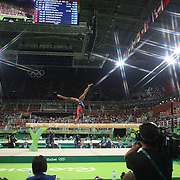 Gymnastics - Olympics: Day 2   Simone Biles #391 of the United States performing her routine on the Balance Beam during the Artistic Gymnastics Women's Team Qualification round at the Rio Olympic Arena on August 7, 2016 in Rio de Janeiro, Brazil. (Photo by Tim Clayton/Corbis via Getty Images)<br /> <br /> (Note to editors: A special effects starburst filter was used in the creation of this image)