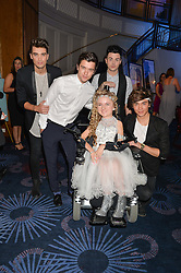 UNION J and girl at The Butterfly Ball in aid of Caudwell Children held at the Grosvenor House, Park Lane, London on 25th June 2015