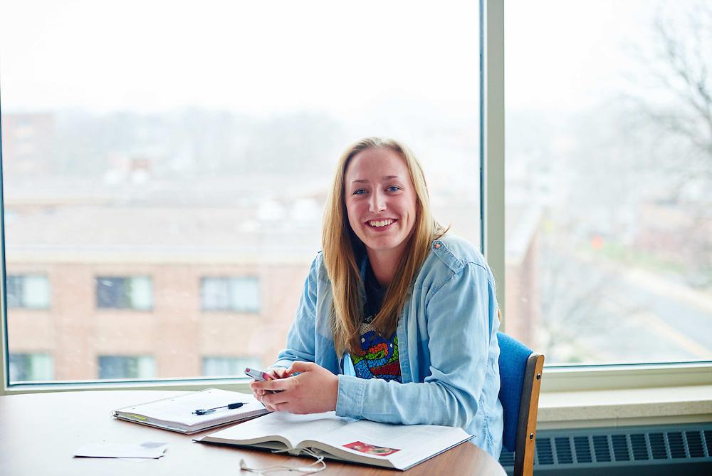 -UWL UW-L UW-La Crosse University of Wisconsin-La Crosse; Chair; day; Desk; Inside; Lifestyle; Notepad; November; Phone Cell Smartphone; Portrait; Reading; Residence dorm; Smiling; snowy; Student students; Studying; Woman women