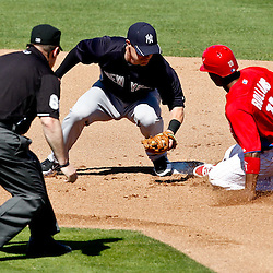 March 05, 2011; Clearwater, FL, USA; Philadelphia Phillies shortstop Jimmy Rollins (11) steals second base past New York Yankees second baseman Jayson Nix (60) during a spring training game at Bright House Networks Field. Mandatory Credit: Derick E. Hingle-US PRESSWIRE