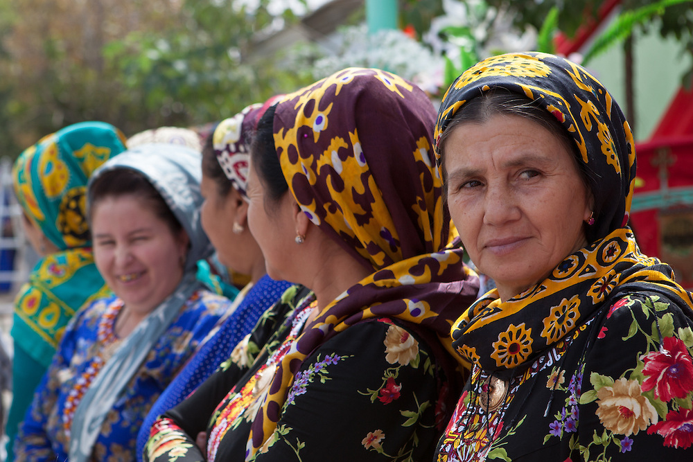 A row of older women in traditional dress and scarf, Ashgabat, Turkmenistan