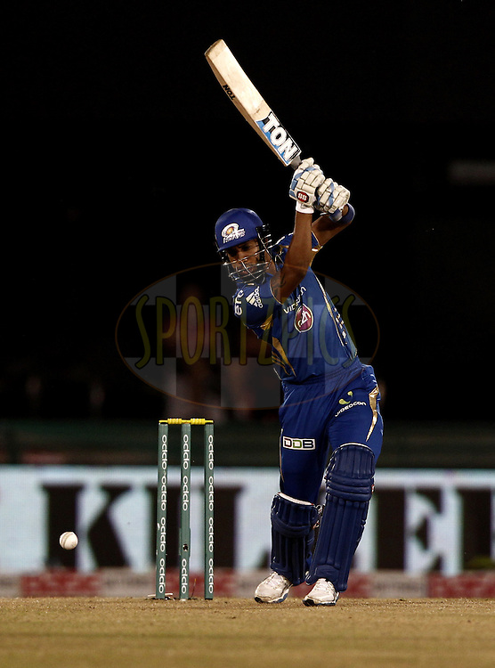 Lendl SIMMONS of the Mumbai Indians during the qualifier 6 match of the Oppo Champions League Twenty20 between the Mumbai Indians and the Northern Knights held at the Chhattisgarh International Cricket Stadium, Raipur, India on the 16th September 2014<br /> <br /> Photo by:  Deepak Malik / Sportzpics/ CLT20<br /> <br /> <br /> Image use is subject to the terms and conditions as laid out by the BCCI/ CLT20.  The terms and conditions can be downloaded here:<br /> <br /> http://sportzpics.photoshelter.com/gallery/CLT20-Image-Terms-and-Conditions-2014/G0000IfNJn535VPU/C0000QhhKadWcjYs