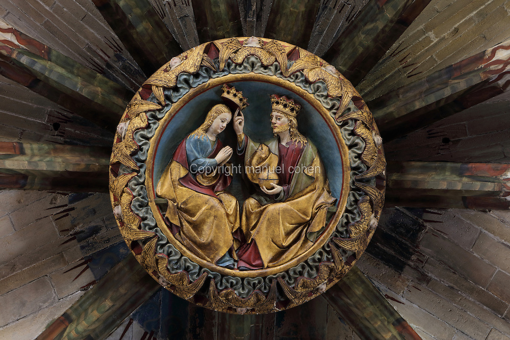 Keystone of the apse, 1440, with the Coronation of the Virgin, in the Cathedral of St Mary, designed by Benito Dalguayre in Catalan Gothic style and begun 1347 on the site of a Romanesque cathedral, consecrated 1447 and completed in 1757, Tortosa, Catalonia, Spain. The cathedral has 3 naves with chapels between the buttresses and an ambulatory with radial chapels. Picture by Manuel Cohen