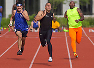 West Point, New York - Army's Michael Kacer, center, wins  his heat of the 100-meters at the 2014 Army Warrior Trials at the United States Military Academy Preparatory School on Tuesday, June 17, 2014.<br />