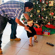 SEBRING, FLORIDA, DECEMBER 17, 2015<br /> Mustapha Thiri plays with his daughter Rokaia Nour Thiri, 15 months old, next to a Christmas tree in his in laws house in Sebring, Fl.<br /> (Photo by Angel Valentin/Freelance)