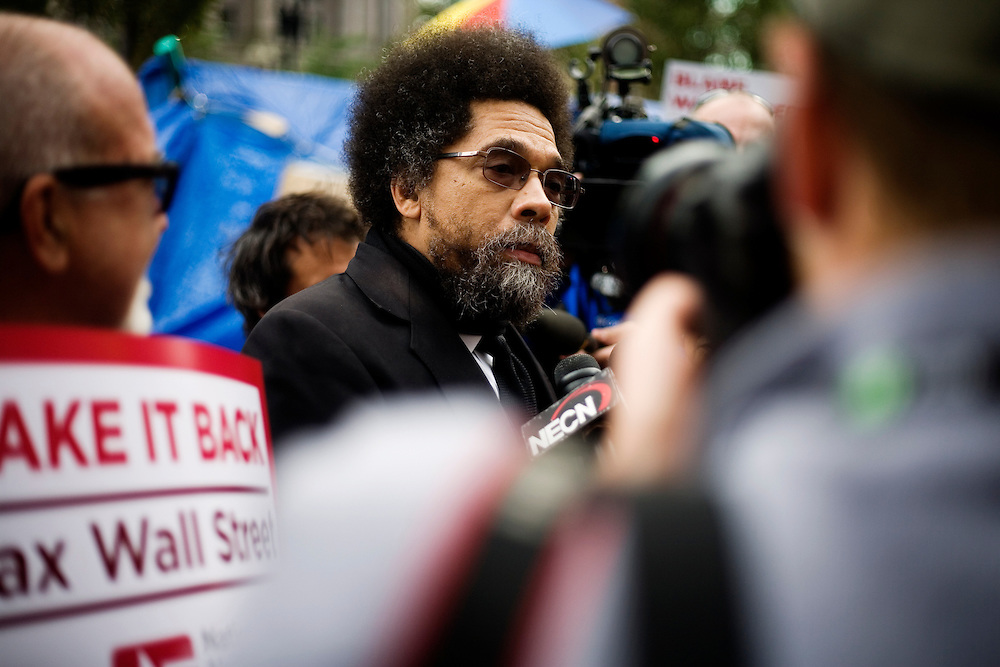 Dr. Cornel West, Princeton University professor and prominent political activist, spoke with media and protestors at the OccupyBoston demonstration in Dewey Square in the Financial District of downtown Boston, Massachusetts, USA. The protesters are part of  OccupyBoston, which is part of the OccupyWallStreet movement, expressing discontent with the socioeconomic situation of the 99% of the US population who are not wealthy.  Protestors have been camping in Dewey Square since Sept. 30, 2011. Gradually, larger organizations, including major labor unions, have expressed their support for the OccupyBoston effort.  On this day, Oct. 5, members of National Nurses United, the largest nurses' union in the US, marched alongside the OccupyBoston protesters.