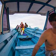 Traveling to Burger World in canoe. Kandui Resort, Mentawais Islands, Indonesia.
