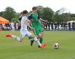 Republic of Ireland's Sean Kennedy races Northern Ireland's Michael Glynn to the ball  during the U16 Uefa development tournament at United park Westport.<br /> Pic Conor McKeown