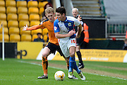 Wolverhampton Wanderers midfielder George Saville holds up Blackburn Rovers midfielder Ben Marshall 0-0 during the Sky Bet Championship match between Wolverhampton Wanderers and Blackburn Rovers at Molineux, Wolverhampton, England on 9 April 2016. Photo by Alan Franklin.