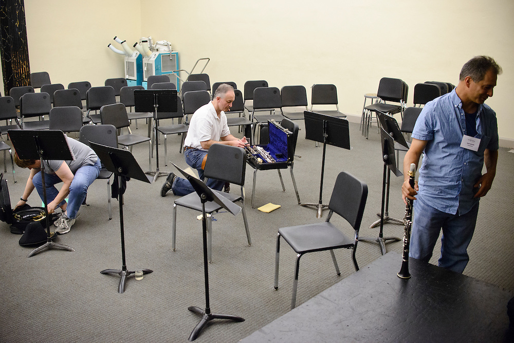(photo by Matt Roth).Assignment ID: 30127886A..Participants in one of the BSO Academy's chamber music groups (L-R) Christina Barkan, French Horn student, Harry Kaplan, bassoon, and Dan Wakin, clarinet, pack up after rehearsing the Adagio cantabile section of Beethoven's Septet in E-flat Major, Op. 20 at the Baltimore School for the Arts Tuesday, June 26, 2012.