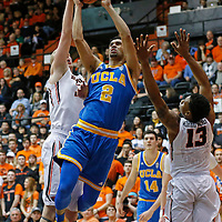UCLA's Noah Allen, center, drives to the basket past Oregon State's Tres Tinkle, left and Langston Morris-Walker in the first half of an NCAA college basketball game in Corvallis, Ore., on Wednesday, Jan. 20, 2016. (AP Photo/Timothy J. Gonzalez)