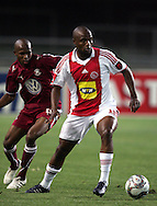 Sifiso Vilakazi and Ramahlwe Mphahlele during the PSL match between Ajax Cape Town and Moroka Swallows held at Newlands Stadium in Cape Town, South Africa on 28 October 2009..Photo by Ron Gaunt/SPORTZPICS
