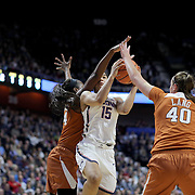 UNCASVILLE, CONNECTICUT- DECEMBER 4: Gabby Williams #15 of the Connecticut Huskies drives to the basket defended by Joyner Holmes #24 of the Texas Longhorns and Kelsey Lang #40 of the Texas Longhorns during the UConn Huskies Vs Texas Longhorns, NCAA Women's Basketball game in the Jimmy V Classic on December 4th, 2016 at the Mohegan Sun Arena, Uncasville, Connecticut. (Photo by Tim Clayton/Corbis via Getty Images)