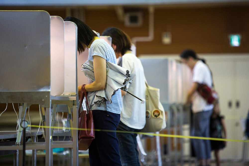 TOKYO, JAPAN - JULY 10 : A woman select his candidate to vote for parliament's upper house election at a polling station in Tokyo, Japan on Sunday, July 10, 2016. The revised law has expanded the electorate by 2.4 million people aged 18 and 19, and is designed to give more political say to younger generations. The first Upper house election nation-wide in Japan that 18 years old can vote after government law changes its voting age from 20 years old to 18 years old. (Photo by Richard Atrero de Guzman/NUR Photo)