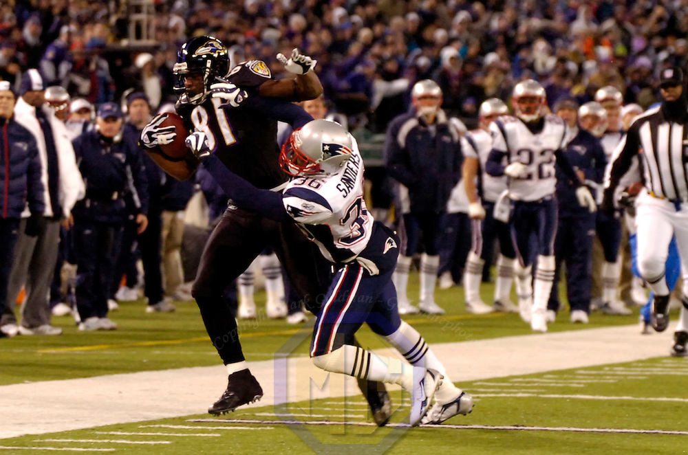 Baltimore Ravens wide receiver Devard Darling (81) catches a pass for a 53 yard gain in the 1st quarter against New England Patriots safety James Sanders (36) on December 3, 2007 at M&T Bank Stadium in Baltimore, Maryland.  The Patriots defeated the Ravens 27-24.