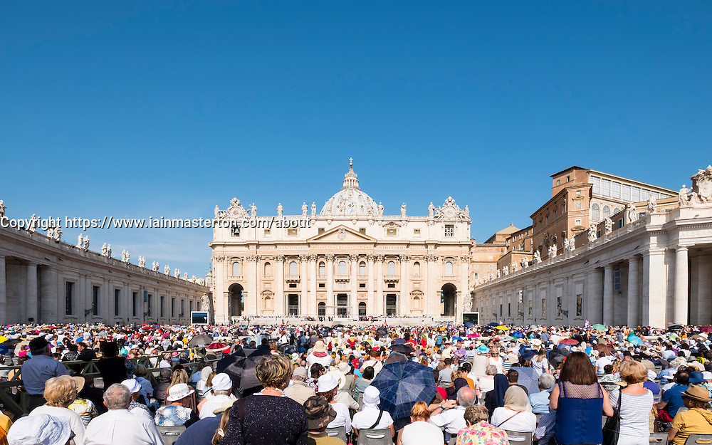 View of St Peters Basilica during general audience with the Pope in St Peter's Square in Vatican City Rome , Italy