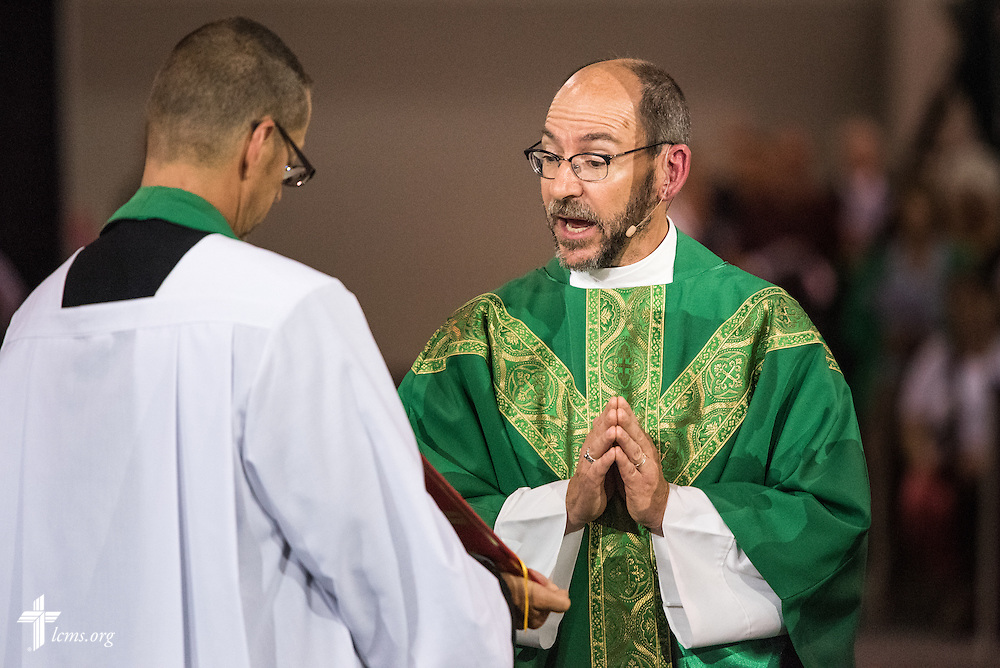 The Rev. Peter C. Bender, pastor of Peace Lutheran Church in Sussex, Wis., reads the Gospel during the Opening Divine Service of the 66th Regular Convention of The Lutheran Church–Missouri Synod on Saturday, July 9, 2016, at the Wisconsin Center in Milwaukee. Next to Bender is the Rev. Will Weedon, chaplain of the LCMS International Center. LCMS/Frank Kohn