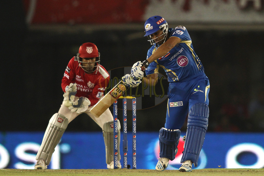 Rohit Sharma captain of of the Mumbai Indians square drives a delivery during match 48 of the Pepsi Indian Premier League Season 2014 between the Kings XI Punjab and the Mumbai Indians held at the Punjab Cricket Association Stadium, Mohali, India on the 21st May  2014<br /> <br /> Photo by Shaun Roy / IPL / SPORTZPICS<br /> <br /> <br /> <br /> Image use subject to terms and conditions which can be found here:  http://sportzpics.photoshelter.com/gallery/Pepsi-IPL-Image-terms-and-conditions/G00004VW1IVJ.gB0/C0000TScjhBM6ikg