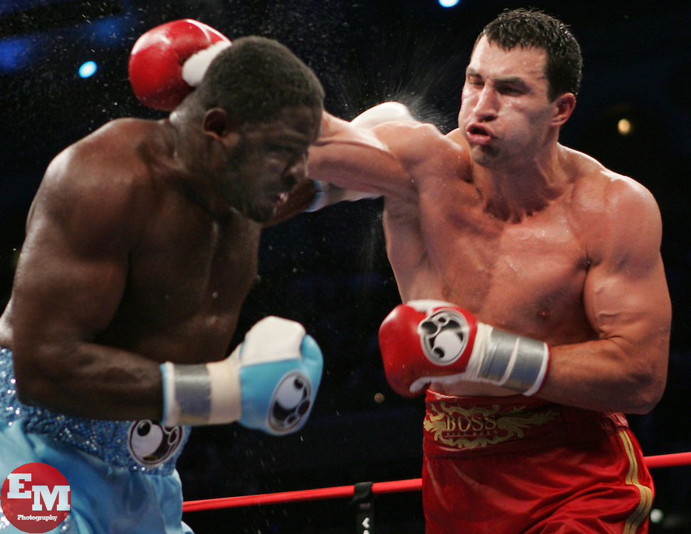 Wladimir Klitschko (r) and Samuel Peter (l) trade punches during their fight