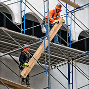 Because of NYC Local Law 11, workers are assembling scaffolding from bottom to top and around the outside of Lenox Health Greenwich Village building. This process will take up to 6 months or more to complete.<br />  <br /> Local Law 11 was passed and signed into law in 1980 after  a student was killed in May 1979 by a piece of terra cotta that  fell from a building.   <br /> <br /> Under that law, the facades of buildings of more than six stories had to be  inspected every five years by a licensed engineer or architect and certified as  safe. Serious deficiencies had to be corrected and the building given a second  inspection.<br /> <br /> __________________________<br /> <br /> The scaffolding company provides the scaffold and shoring erection and dismantle services.<br /> <br /> Scaffolding  is a temporary structure for holding workers and materials during the erection, repair, or decoration of a building.