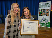 Sam Moore, left, and Rebecca Ryan, right, pose for a photograph after Ryan was presented with a Humanities Texas 2015 Outstanding Teaching of the Humanities Award at Leland College Preparatory Academy for Young Men, February 2, 2016.