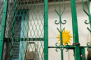 Detail of green gate and yellow sun painting on the Amalfi Coast of Italy