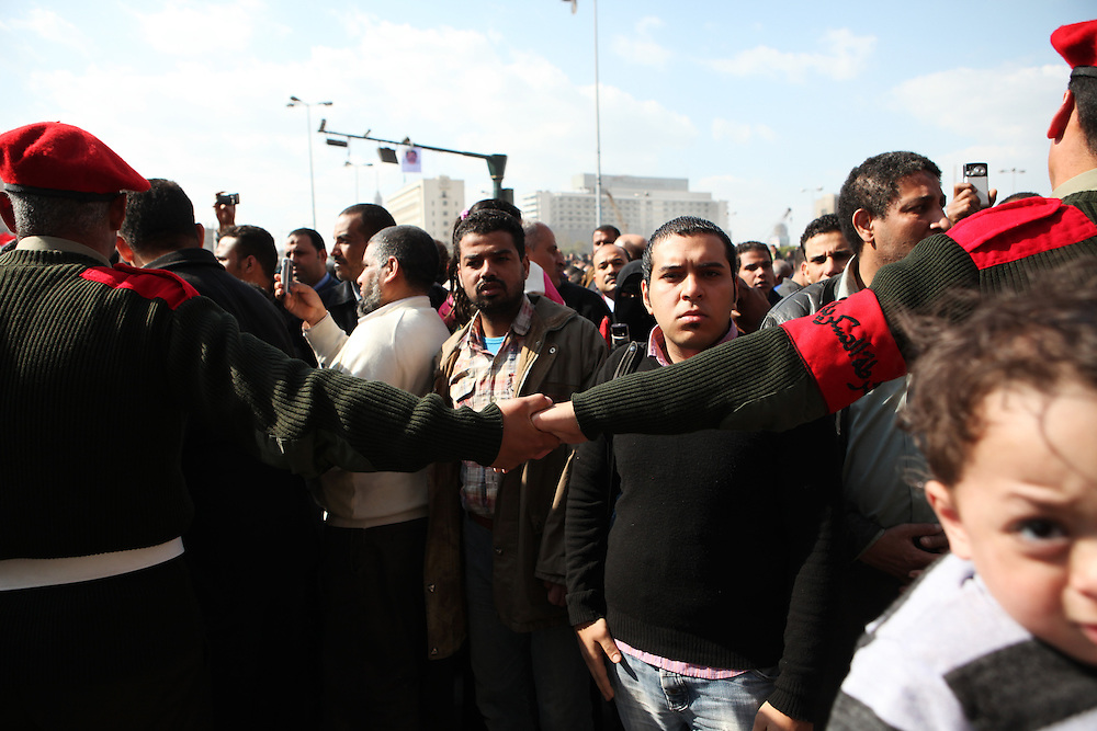 Two days after Mubarak stepped down, hundreds of protesters remained at Tahrir before being forced out by the Egyptian military.