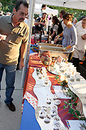A man looks over the samples from Bellyfire Catering during the 21st annual The Taste in the Lincoln Park Commons area at the Fraze Pavilion, Thursday, September 3, 2009.