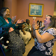 MANASSAS, VA - NOV21:  Rosa Valqui, 89, dances with activity aide Tina Burhans-Robinson, during karaoke at Birmingham Green, an elder care residence in Manassas, VA, November 21, 2014. With the U.S. population aging and Alzheimer's more widespread, science is looking for ways to slow or delay the onset of dementia in aging Americans. Among the approaches is trying to determine whether art, music and dance or movement can also alleviate the problems attendant with dementia. The federal government is funding a study at Birmingham Green with George Mason University to see whether there is a scientific basis to believe that art is actually medically beneficial. (Photo by Evelyn Hockstein/For The Washington Post)