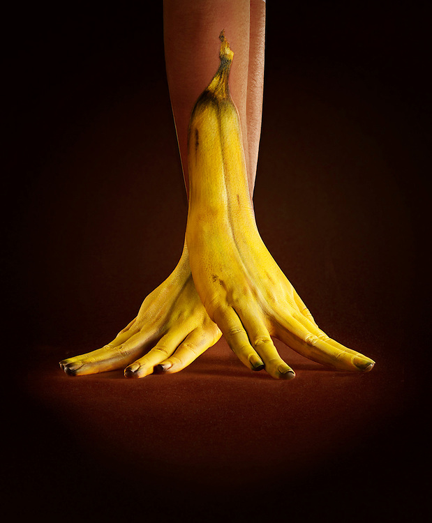 Hands painted to look like Banana's, Ray Massey is an established, award winning, UK professional photographer, shooting creative advertising and editorial images from his stunning studio in a converted church in Camden Town, London NW1. Ray Massey specialises in drinks and liquids, still life and hands, product, gymnastics, special effects (sfx) and location photography. He is particularly known for dynamic high speed action shots of pours, bubbles, splashes and explosions in beers, champagnes, sodas, cocktails and beverages of all descriptions, as well as perfumes, paint, ink, water – even ice! Ray Massey works throughout the world with advertising agencies, designers, design groups, PR companies and directly with clients. He regularly manages the entire creative process, including post-production composition, manipulation and retouching, working with his team of retouchers to produce final images ready for publication.