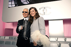German fashion designer Karl Lagerfeld poses with French actress Anna Mouglalis after the presentation of his Spring-Summer 2006 ready-to-wear collection for French fashion house Chanel at the Grand Palais in Paris, France, on October 7, 2005. Photo by Nebinger-Orban-Zabulon/ABACAPRESS.COM