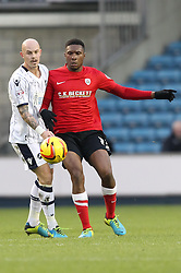 Barnsley's Kelvin Etuhu vies for possession with Millwall's Richard Chaplow - Photo mandatory by-line: Robin White/JMP - Tel: Mobile: 07966 386802 23/11/2013 - SPORT - Football - Millwall - The Den - Millwall v Barnsley - Sky Bet Championship