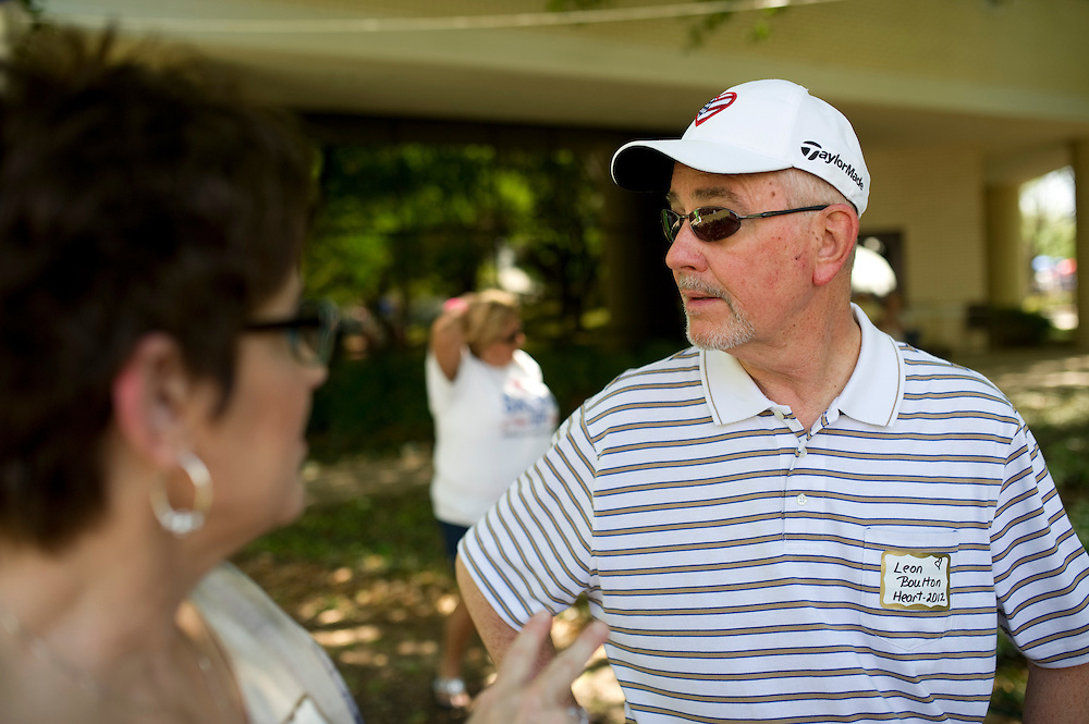 "Leon Boulton and his wife Cindy talk during the Baylor University Medical Center ""transplant reunion"" in Dallas on Sunday, April 14, 2013. Leon received a heart transplant in November of 2012 and completed a golf tournament t months later. (Cooper Neill/The Dallas Morning News)"